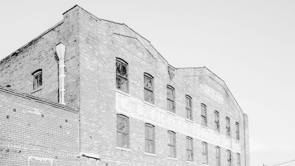 Historic photo of The Ficklen, a warehouse in Greenville NC that's revitalized as a food hall and hotel